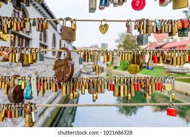 Ljubljana, Slovenia-September 11, 2016: wedding castles on the bridge in the centre of Ljubljana. It's a tradition to hang locks on a bridge on your wedding day.