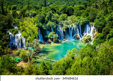 LJUBUSKI, BOSNIA AND HERZEGOVINA - AUGUST 10, 2014: Many tourists visit Kravice waterfalls on Trebizat River near Ljubuski in Bosnia and Herzegovina.