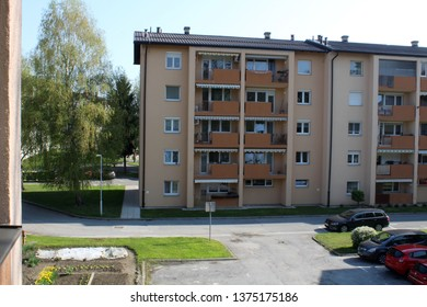 Ljutomer / Slovenia - 04 18 2019: Balcony View on a Building and a litlle park in spring.
