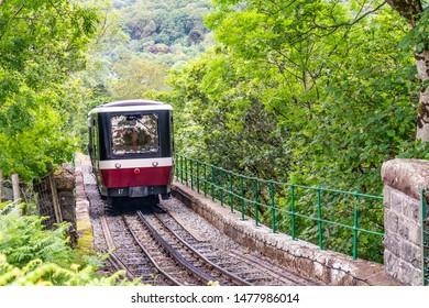 Llanberis, Wales, UK – July 01 2019. Mount Snowdon Railway, Llanberis, North Wales. A diesel train carrying passengers to the summit of Mount Snowdon