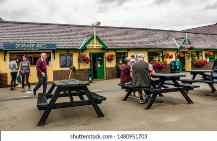Llanberis, Wales, UK – June 30 2019. Mount Snowdon Railway passengers outside Llanberis train station for the arrival of the diesel train that will carry them to the summit of Mount Snowdon