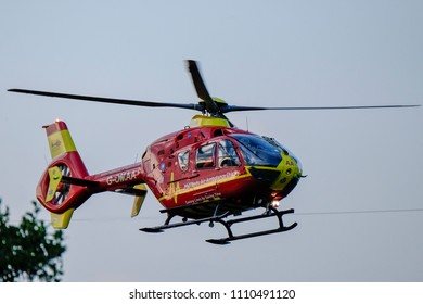Llanbradach, Caerphilly Wales UK 06/11/2018: Midlands air ambulance leaving scene of explosion and house fire