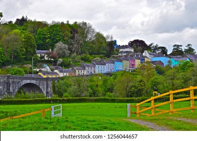 Llandeilo, Carmarthenshire / Wales UK - 5/10/2018: Pretty pastel coloured houses line the winding road over the bridge across the river Towy, up to the rural Welsh town of Llandeilo.