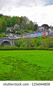 Llandeilo, Carmarthenshire / Wales UK - 5/10/2018:Pretty pastel coloured houses line the winding road over the bridge across the river Towy, up to the rural Welsh town of Llandeilo.
