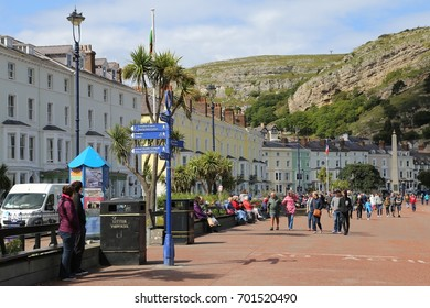 Llandudno, Conwy, Wales, UK.  19 August 2017.  People walking along the promenade.