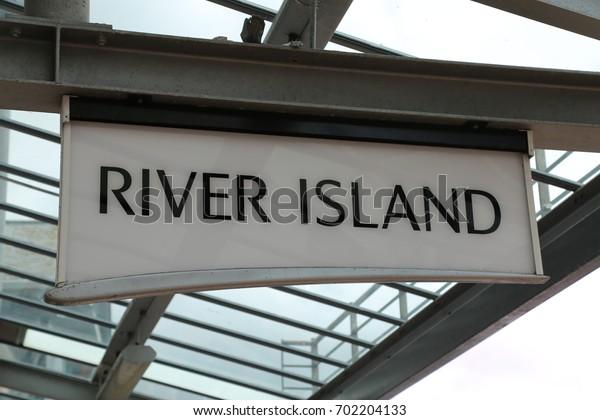 Llandudno, Conwy, Wales, UK.  19 August 2017.  River Island fashion shop sign.