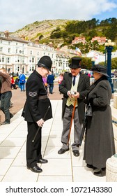 Llandudno, North Wales- 29th April 2017: Three people dressed in Victorian costumes  in Llandudno as part of Llandudno Victorian extravaganza holiday weekend.