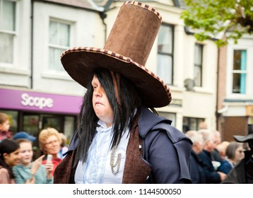 Llandudno, North Wales- 29th April 2017: Large Man in fancy dress costume, with fangs and brown top hat, part of the Llandudno extravaganza weekend