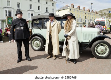 Llandudno, North Wales- 29th April 2017: People dressed in Victorian costume standing alongside a vintage citron car at Llandudno promenade as part of Llandudno Victorian extravaganza holiday weekend.