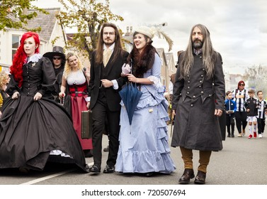 Llandudno, North Wales- 29th April 2017: People dressed in fancy dress costume walking in a parade in Llandudno as part of Llandudno Victorian extravaganza holiday weekend.