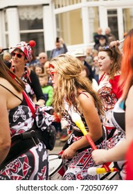 Llandudno, North Wales- 29th April 2017: Performers of the Batala Mersey carnival band  in Llandudno as part of Llandudno Victorian extravaganza holiday weekend.