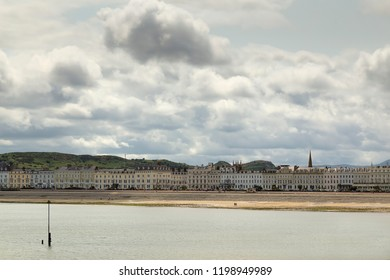 LLANDUDNO, NORTH WALES, UK - JULY 12, 2015: Llandudno Promenade with its beautiful Victorian buildings from the 1800's era.  Many of the buildings are now hotels retaining their original appearance.