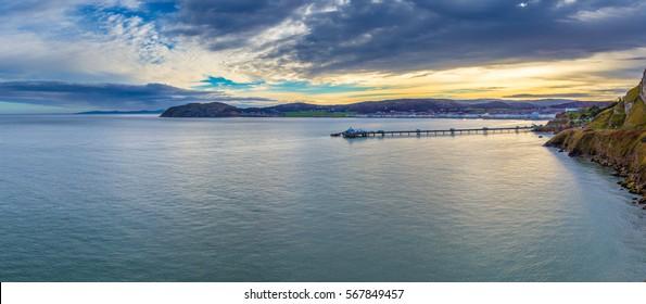 Llandudno Pier at sunrise, Llandudno North Wales UK