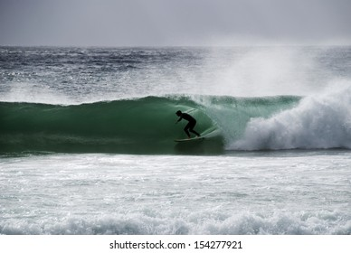 LLANDUDNO, SOUTH AFRICA - FEBRUARY 05: Surfing a barrel. February 5th 2011. Llandudno Beach is one of the Cape's most beautiful beaches, surrounded by large granite boulders,overlooked by mountains.
