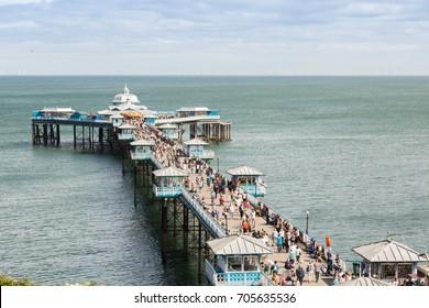 LLANDUDNO UK -  AUGUST 28th  2017: The pier, a popular tourist destination in Llandudno North Wales.