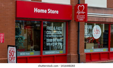 Llandudno, UK - May 6, 2019: The Llandudno branch of the British Heart Foundation Home Store. The charity shop specialises in used furniture, household appliances and electrical goods.