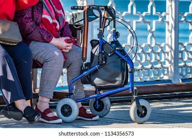 LLANDUDNO / WALES - APRIL 23 2018 : Folks enjoying the Pier at the seaside resort of Llandudno, North Wales, United Kingdom