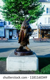 Llandudno, Wales- August 28,2018: A picture of Alice in Wonderland character statue at the front store near Llandudno town in the morning.""