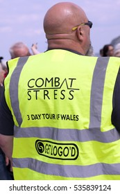 Llandudno, Wales- May 18th  2014: Bald headed man wearing high visibility jacket promoting 3-day tour of Wales. The Motorcycle tour was in aid of raising funds for the veteran mental health charity.