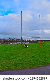 Llanelli, Carmarthenshire / Wales UK - 1/19/2019: Sculture with Phil Bennett of  Llanelli & old Stradey Park posts with Sospan emblems on top, recalling their historic win over All Blacks in 1972.