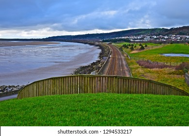 Llanelli, Carmarthenshire / Wales UK - 1/19/2019: A panoramic view of the coastal railway line from Swansea to Carmarthen taken from above the tunnel at Sandy Water Park on the Wales Coastal Path.