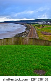 Llanelli, Carmarthenshire / Wales UK - 1/19/2019: A panoramic view of the coastal railway line from Swansea to Carmarthen taken from above the tunnel at Sandy Water Park on the Welsh Coastal Path.