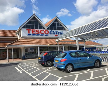 Llanelli, UK: June 14, 2018: Main entrance to a Tesco Extra superstore. Disabled parking spaces give easy access to the store. Tesco is the UK's largest supermarket chain.