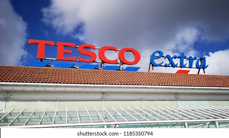 Llanelli, UK: September, 2018: Commercial signage of a Tesco Extra superstore. Tesco is a British multinational grocery and general merchandise retailer it is the third-largest retailer in the world.