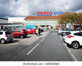 Llanelli, UK: September 21, 2018: Customers enter a Tesco Extra superstore. Tesco is a British multinational grocery and general merchandise retailer. It is the third-largest retailer in the world.