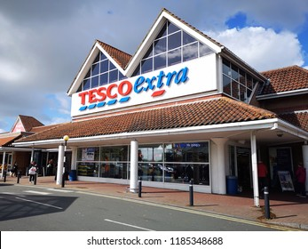 Llanelli, UK: September 21, 2018: Customers enter a Tesco Extra superstore. Tesco is a British multinational groceries and general merchandise retailer. It is the third-largest retailer in the world.