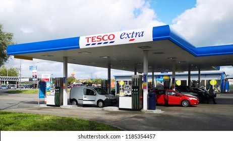 Llanelli, UK: September 21, 2018: Customers refuel their cars at a Tesco Petrol Station. Tesco is a British multinational groceries and general merchandise retailer.