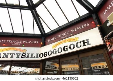 LLANFAIRPWLL, WALES - JULY 11, 2016: Town of Llanfairpwllgwyngyllgogerychwyrndrobwllllantysiliogogogoch (58 letter),  second longest official one-word place name in the world.