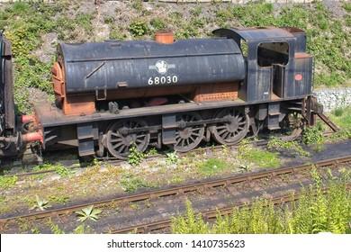 Llangollen, Denbighshire, Wales. 13th May, 2019. A closeup of a derelict 0-6-0 saddle tank engine 68030 awaiting restoration on the Llangollen Railway.