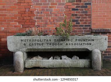 Llangollen, Denbighshire, Wales, UK. January 25, 2019. An old animal trough reused as a town centre planter.