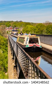 LlangollenDengighshireWalesMay 14, 2019Narrow boats on the Llangollen Canal as it crosses the Pontcysyllte aquaduct, a world heritage site