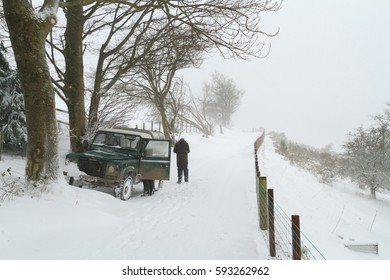 Llangollen North Wales UK -18 January 2013: Farmer attempts to reach livestock during blizzard conditions