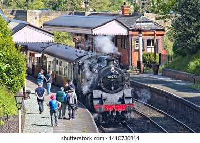 Llangollen Station, Denbighshire, Wales, 13th May, 2019. A steam engine Standard Class 4 Tank – 80072  passenger steam train at the station with passengers on the Llangollen Railway in Wales.