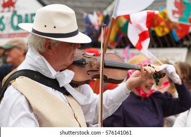 Llangollen Wales UK - July 7 2015: German folk violinist in the annual International Eisteddfod street parade in Llangollen North Wales a music festival celebrating traditional folk music and dancing