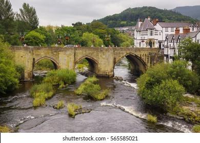 Llangollen, Wales, UK - September 13 2016: The Dee Bridge in Llangollen one of the Seven Wonders of Wales built in 1345 it is the main crossing over the River Dee or Afon Dyfrdwy in Welsh