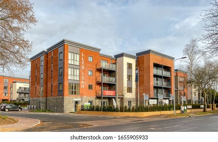 LLANISHEN, CARDIFF, WALES - DECEMBER 2019: New block of flats for sale in the suburbs of Cardiff. The site was redeveloped after demolition of an old office block.