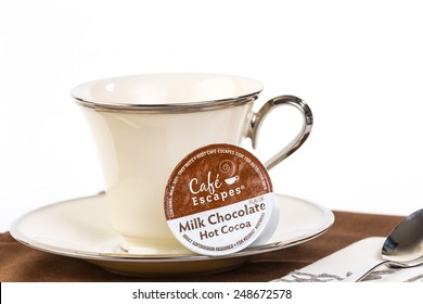LLANO, TEXAS-JAN 31, 2015:  Cafe Escapes brand of Hot Cocoa K-Cup with elegant fine china against white background with copy space.  Made for Keurig Brewing Machines.
