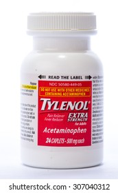 LLANO, TX-AUG 16, 2015: Bottle of Tylenol Extra Strength Pain Reliever and Fever Reducer against white background with copy space.  Vertical format.