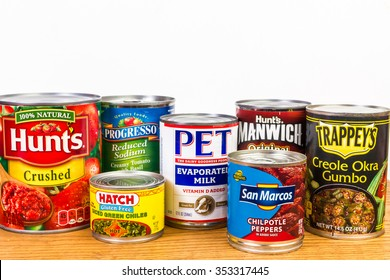 LLANO, TX-DEC 19, 2015: Donated canned goods on shelf at Food Pantry for the needy.  White Background with  copy space.
