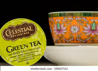 LLANO TX-JULY 20, 2015: Keurig K-cup of Celestial Seasonings Green Tea against black background with oriental design tea cup to simulate drinking tea in China.