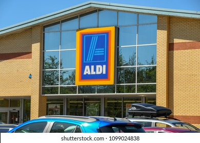 LLANTRISANT, WALES - MAY 2018: Large sign above the entrance on the front of an ALDI supermarket with cars parked the car park in front of the shop