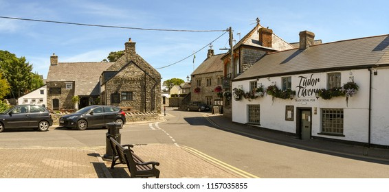 LLANTWIT MAJOR, VALE OF GLAMORGAN, WALES - JULY 2018: Two very old pubs in Llantwit Major in the Vale of Glamorgan. The Old Swan Inn on the left and the Tudor Tavern on the right.