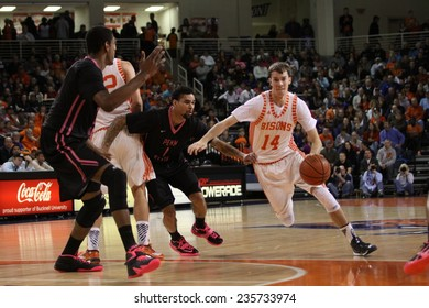 LLEWISBURG, PA. - NOVEMBER 28: Bucknell's #14 Chris Hass drives to the basket l during a basketball game against Penn Statel on November 28, 2014 Sojka Pavilion in Lewisburg, PA.