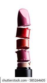 Llipstick of different pieces of broken lipstick. Concept on a white background
