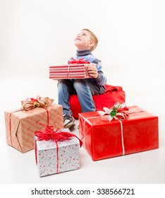 Llittle boy with gifts on white background. Chrismas