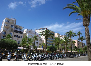 LLORET DE MAR, BARCELONA, SPAIN: July 13, 2016. City view during the summer. Palmtrees with building and motobikes parking. Lloret De Mar is near Barcelona in Catalonia; Spain.